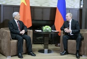 General Secretary of the Central Committee of the Communist Party of Vietnam Nguyen Phu Trong (L) and Russian President Vladimir Putin (R)