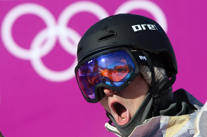 Ryan Stassel of the US reacts after his first run during heat two of the Men's Snowboard Slopestyle qualification at Rosa Khutor Extreme Park at the Sochi 2014 Olympic Games, Krasnaya Polyana, Russia